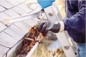 Gutters being cleaned from a new roof in Johnson County