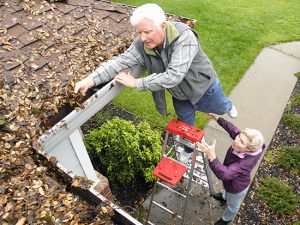 man on ladder almost falling needs a roof repair in Johnson County