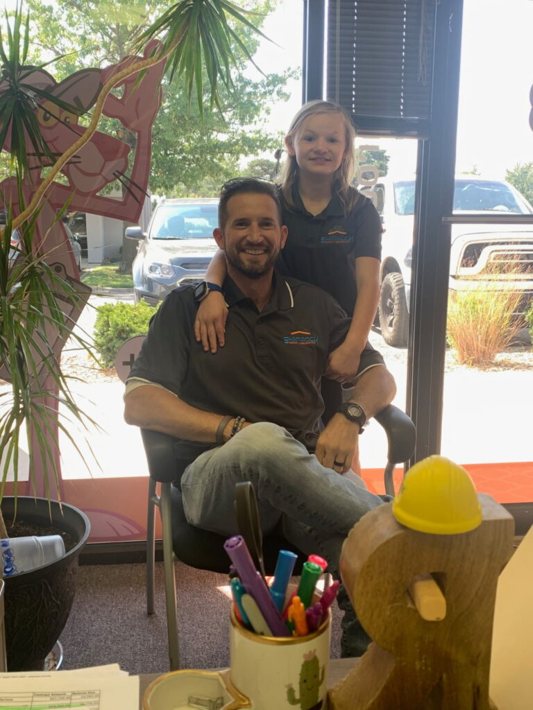 Garen Armstrong, executive director of Shamrock Roofing & Construction, and his daughter Abby.